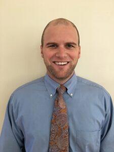 Headshot of Pennies for Progress Program Manager, Patrick Hamilton
